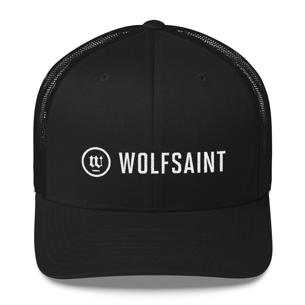 A black on black classic retro truckers cap with the WOLFSAINT gothic logo and circle crest in white on the front panels. From Wolfsaint.net