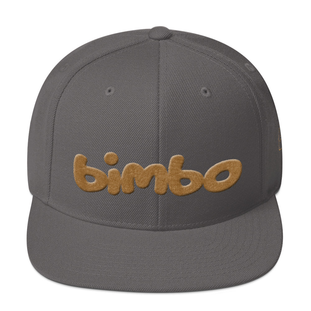 Gray retro, classic snapback baseball cap with the sarcastic/ironic word BIMBO embroidered in a streetwise bubble / graffiti font for skateboarders, rappers, athletes, etc. From wolfsaint.net