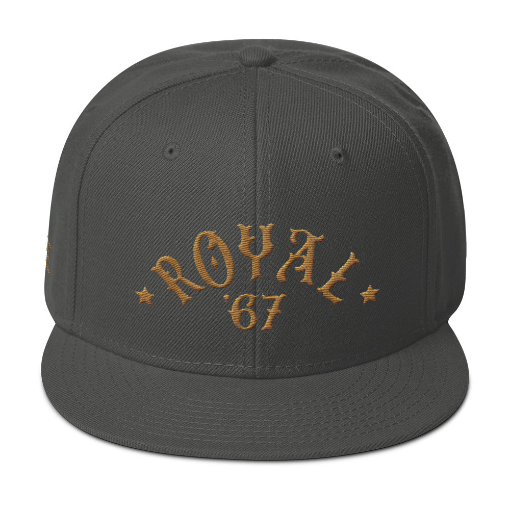 "A retro gray SnapBack cap with ""ROYAL"" in classic vintage typography embroidered in an arc above the year '67. For Wolfsaint.net"