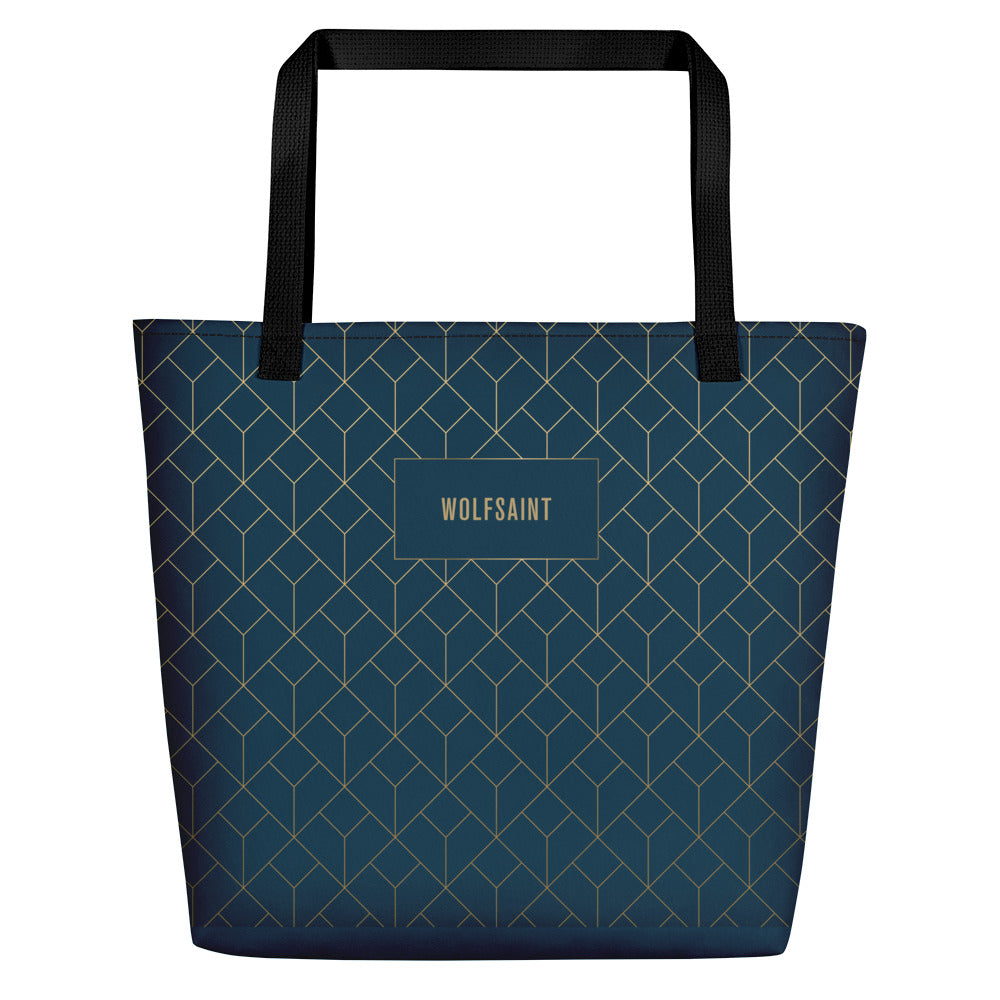 An elegant, fashionable unisex beach or city tote bag in Sea Blue, with an Art Deco style geometric print in 'gold' with the WOLFSAINT gothic logo within a blue box. From Wolfsaint.net