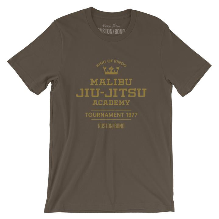 A fashionable, vintage-inspired retro t-shirt in Army green, featuring a graphic commemorating a sarcastic and fictitious Malibu (California) Jiu Jitsu academy and a 1977 tournament. By fashion brand Ruston/Bond, from wolfsaint.net