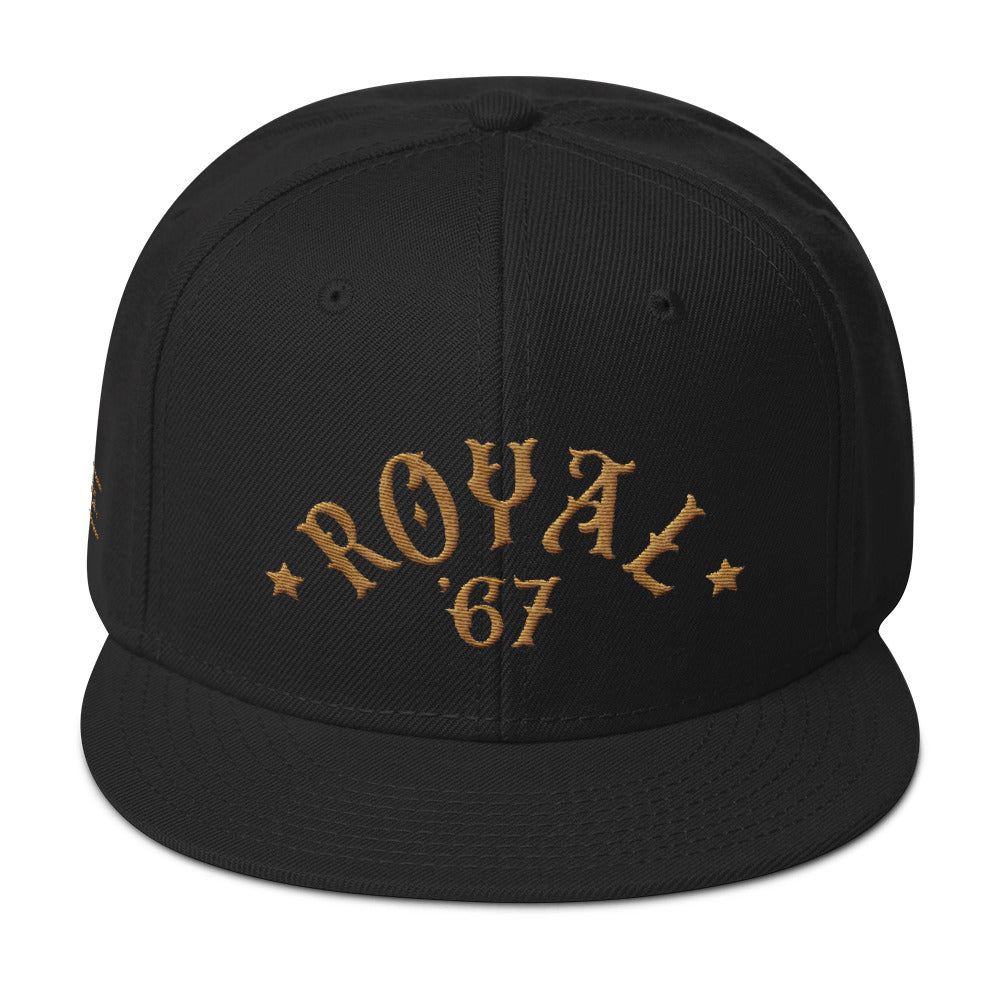 "A retro black SnapBack cap with ""ROYAL"" in classic vintage typography embroidered in an arc above the year '67. For Wolfsaint.net"