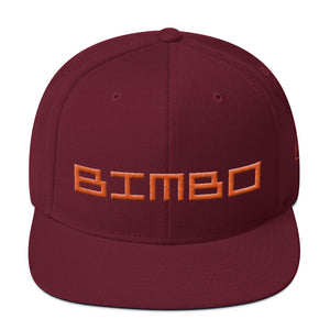 Red / Maroon retro, classic snapback baseball cap with the sarcastic/ironic word BIMBO embroidered in a streetwise square techno font for skateboarders, rappers, athletes, etc. From wolfsaint.net