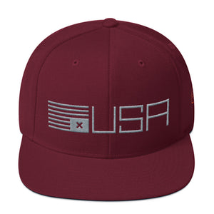 "A classic cap featuring a political statement about the American democracy, showing an upside down simplified American flag with an X instead of stars, letters ""USA"" From wolfsaint.net"