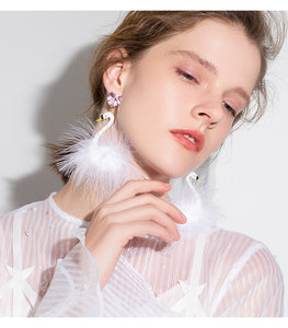 Cute wind white swan modeling earrings female fashion personality long hair ball earrings for girls