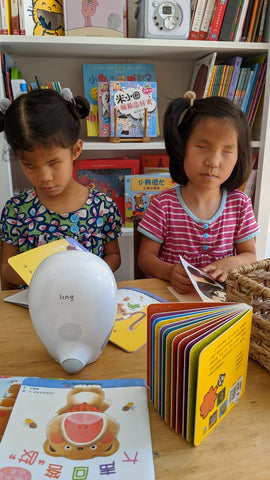 Visually Impaired Girls Using Luka Reading Companion