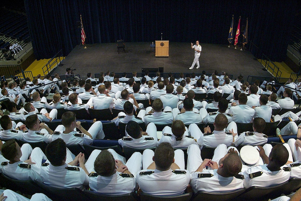 Midshipmen receiving a brief from an Admiral in Alumni Hall, Annapolis, MD (2006)
