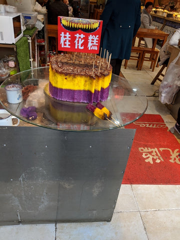 Tri-color purple yellow brown Ozmanthus cake in Chinese cafe