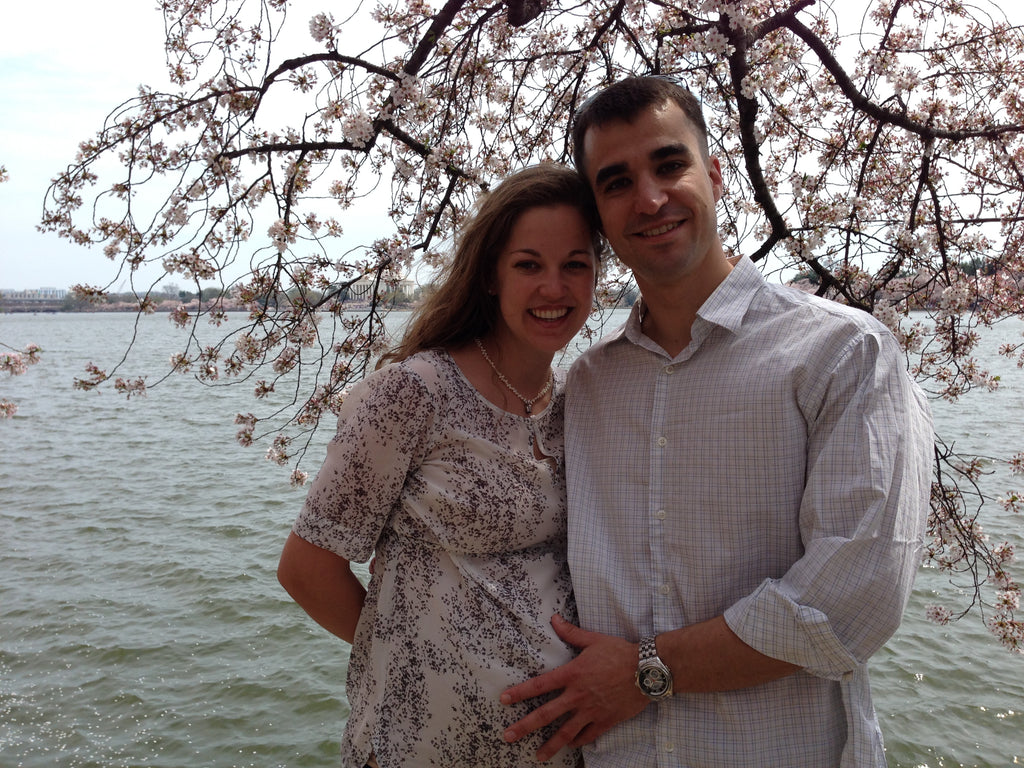 Couple with pregnant woman at Cherry Blossom festival in Washington D.C.