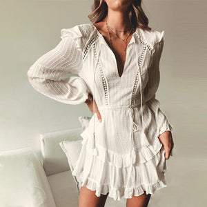 White layered mini dress with sleeves and detailed edging