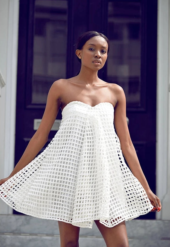 White mini dress with net overlay