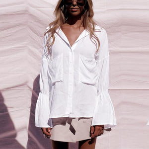 White blouse with pockets and gathered sleeves