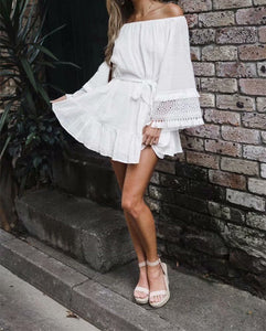 White oversized dress with tassels