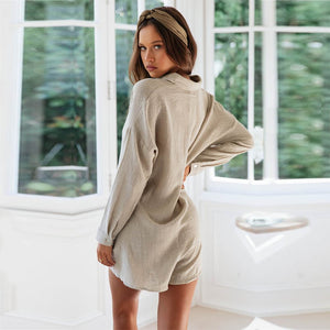Beige playsuit with buttons and long sleeves