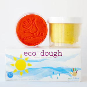 eco-dough with two canisters of dough in orange and yellow