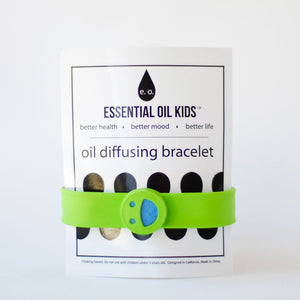 Essential Oil Kids Oil Diffusing Bracelet in lime green color, smiley face on silicon snap-style bracelet