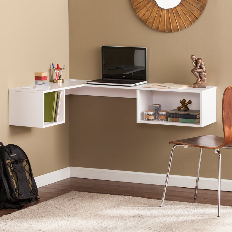 Fynn Wall Mount Corner Desk - lifestyle photo - laptop on top, books inside the shelves, and a desk chair