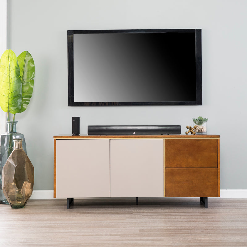 Midhurst Storage Media Stand front lifestyle view. Shown with TV mounted above with sound bar and decor on top. White contrasting doors on the left and two drawers on the right.