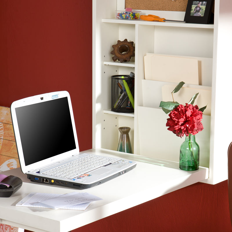 White Wall-Mounted Desk - close up lifestyle photo - shown open with laptop vase with flower and pens, scissors, and a photo