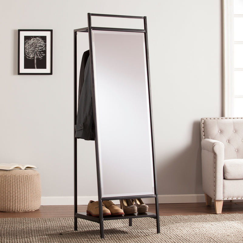 Drake Mirror/Hidden Coat Rack Lifestyle Photo. Mirror is angled to show coats hanging behind mirror and shoes on the bottom shelf.
