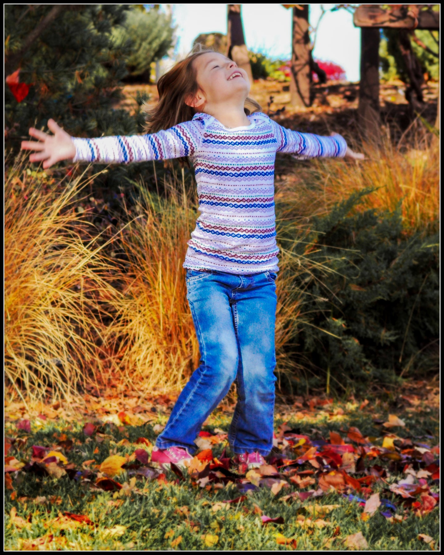 Girl Spinning in Fall Leaves - Tracy McCrackin Photography