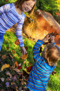 Kids playing in Fall Leaves - Tracy McCrackin Photography