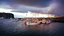 Load image into Gallery viewer, Harbor Boats in Iceland During Sunset with Lighthouse - Tracy McCrackin Photography