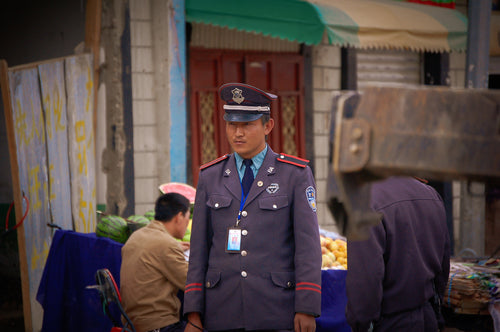 Tibetian Police in Llasa, Tibet - Tracy McCrackin Photography