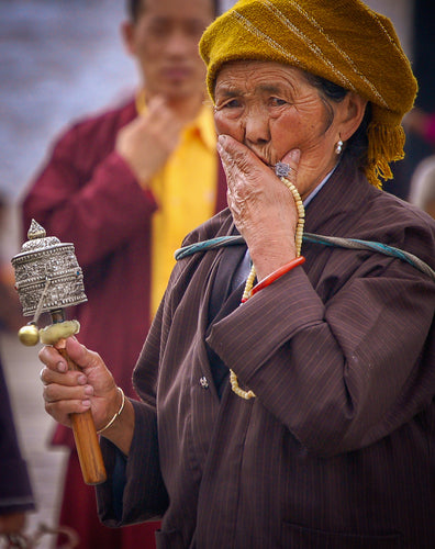 Colorful Tibetian Women with Prayer Wheel - Tracy McCrackin Photography