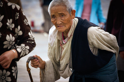 White haired Tibetan with Cane - Tracy McCrackin Photography