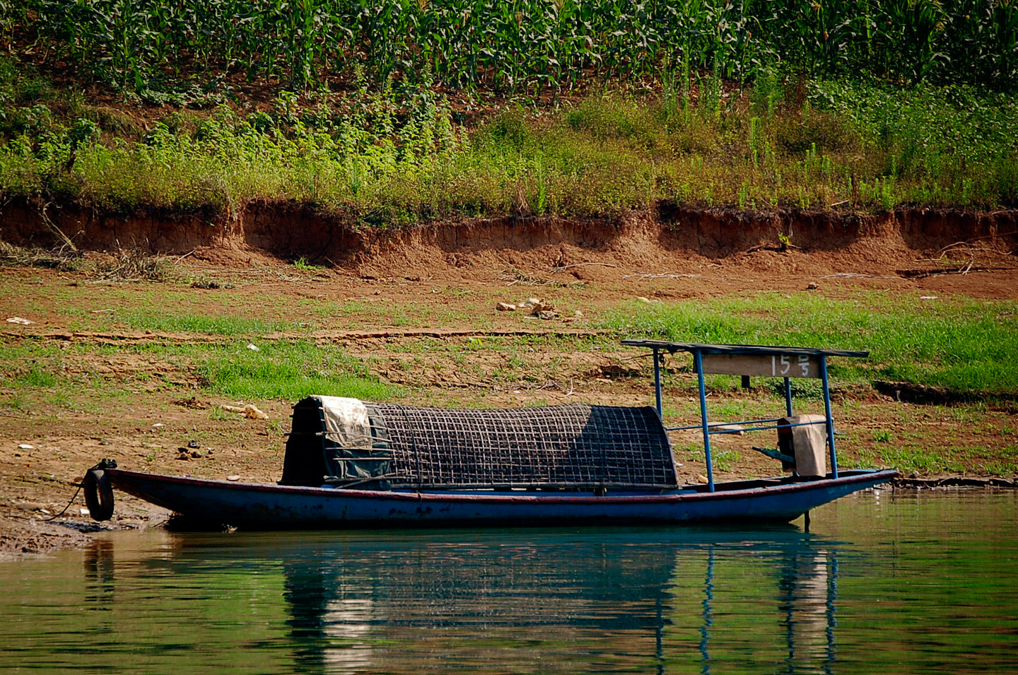 Chinese Farmer with Fishing Boat