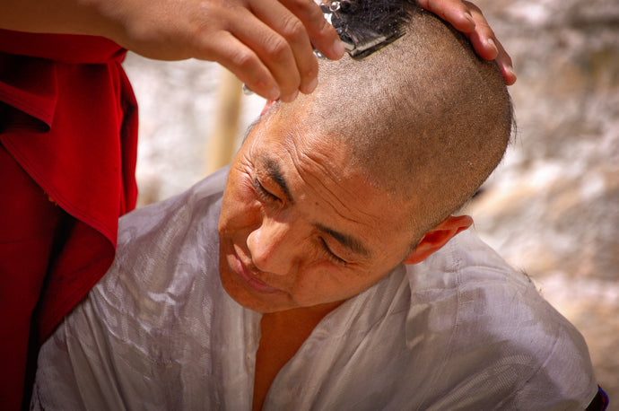 Close Up of Monk Getting Head Shaved