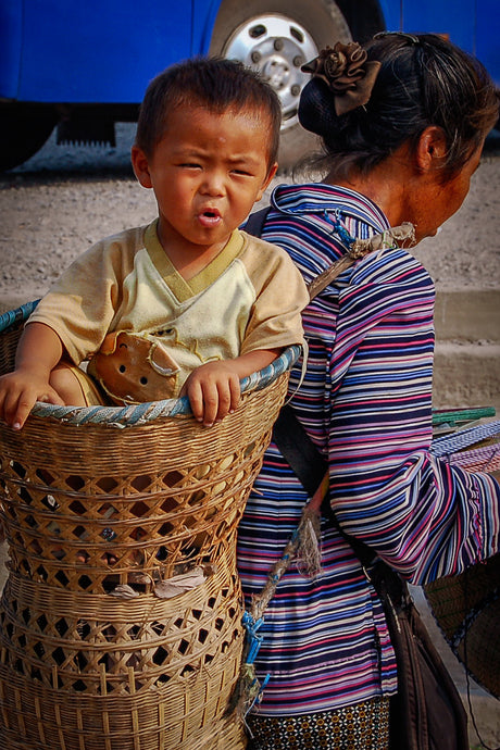 Mother and Son, Wearing Basket