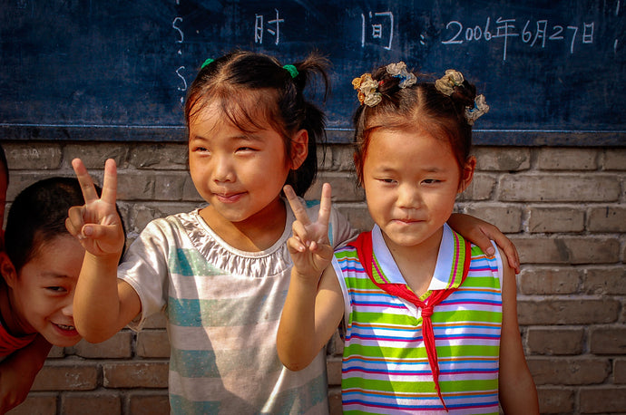 Chinese School Girls giving Peace Sign