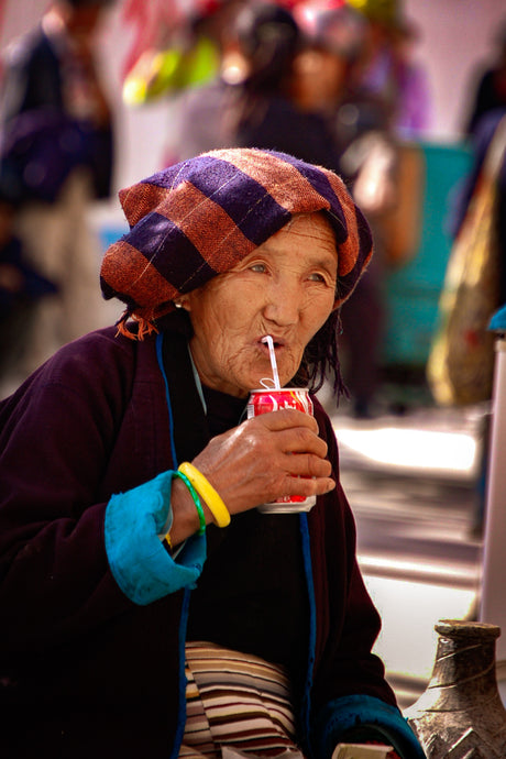Tibetan Woman Drinking a Coke - Tracy McCrackin Photography