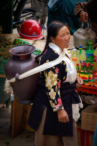 Tibetan Women Carrying a Jar on Her Back - Tracy McCrackin Photography