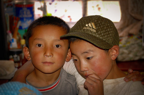 Tibetan Orphans Hugging - Tracy McCrackin Photography
