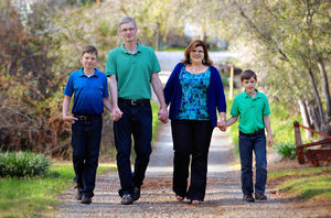 Family Holding Hands at Park Walking - Tracy McCrackin Photography