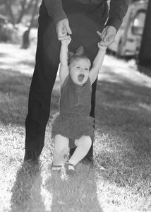 Child Swinging with Father Red Dress - Tracy McCrackin Photography