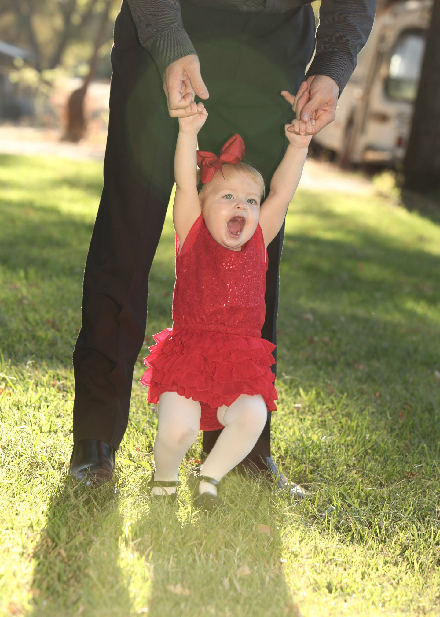 Child Swinging with Father Red Dress