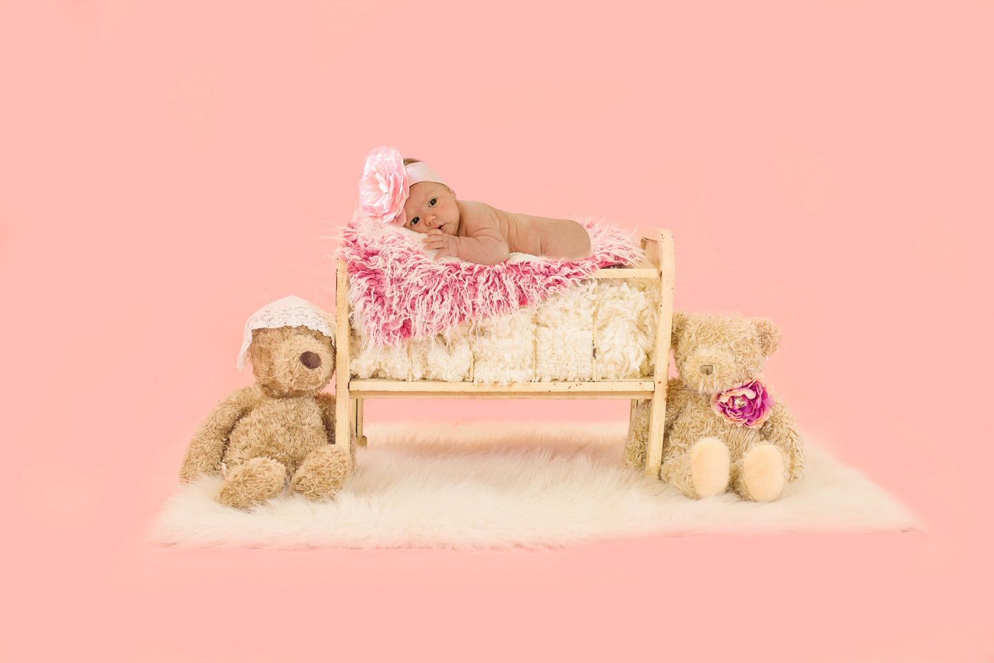 Baby in a Cradle with Teddy Bear