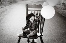 Load image into Gallery viewer, Birthday boy on a red chair - Tracy McCrackin Photography