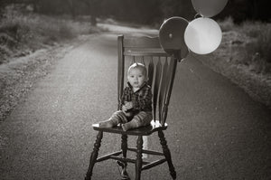 Birthday boy on a red chair - Tracy McCrackin Photography