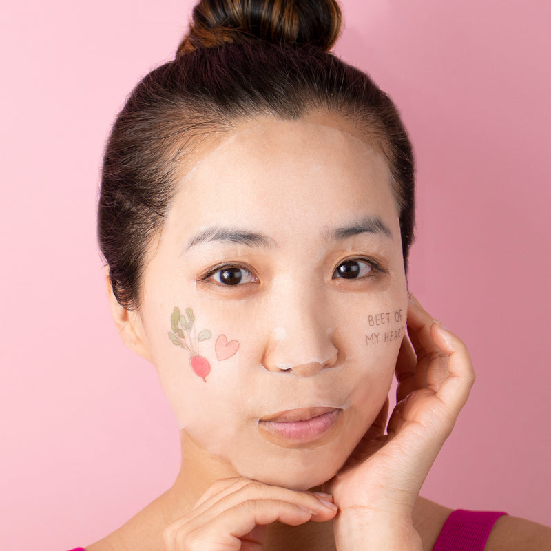 model wearing a sheet mask