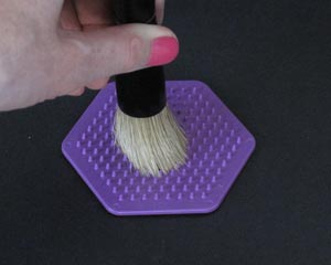 clean your stencil brush with a scrubber