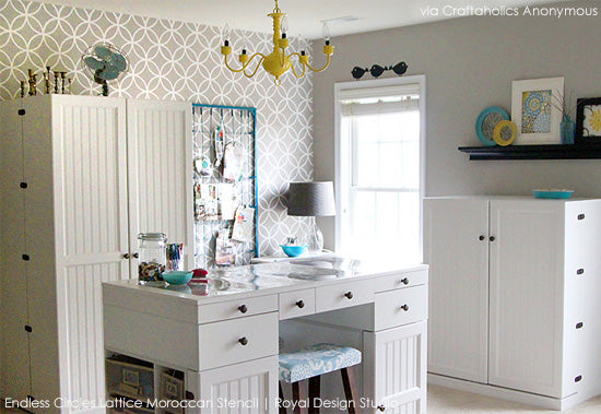 Amazing craft room space with stenciled walls and tons of storage