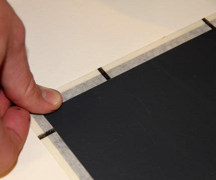 mark off stencil placement with tape