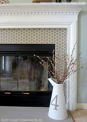 cute bee stencil with honeycomb pattern for chic and modern fireplace design - Royal Design Studio