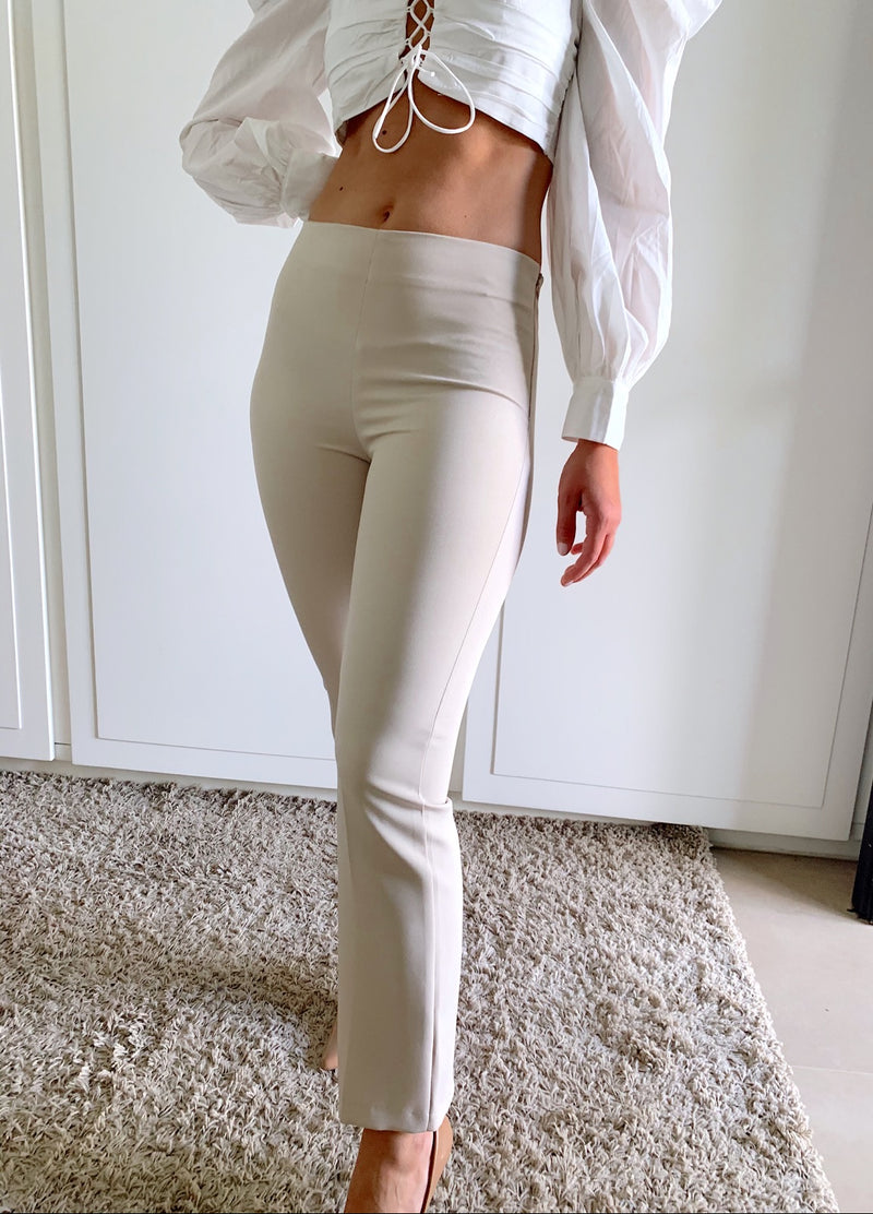 LIGHT BEIGE FLARED TROUSER - Trousers - Shop Fashion at LE TRÉ
