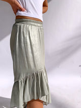 ASYAMMETRIC SKIRT WITH FRILL DETAIL IN SHINY GREEN